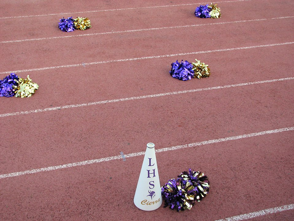 Pom poms and a megaphone on a track field : Free Stock Photo