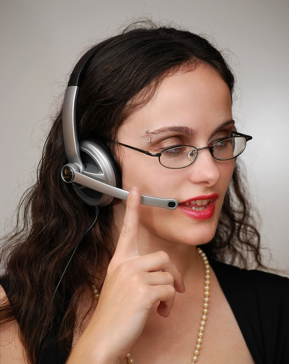 A beautiful business woman talking on a headset : Free Stock Photo