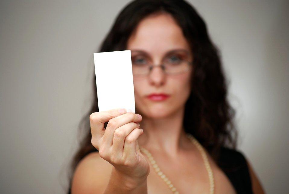 Businesswoman free stock photo a beautiful business woman a beautiful business woman holding a blank business card free stock photo reheart Images