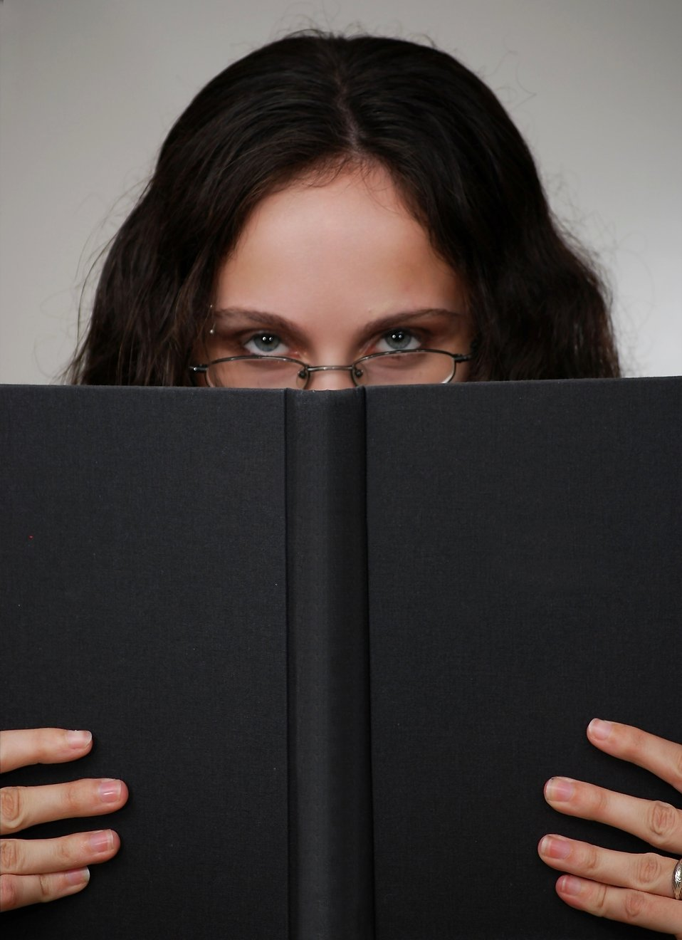 A beautiful business woman looking over a book : Free Stock Photo