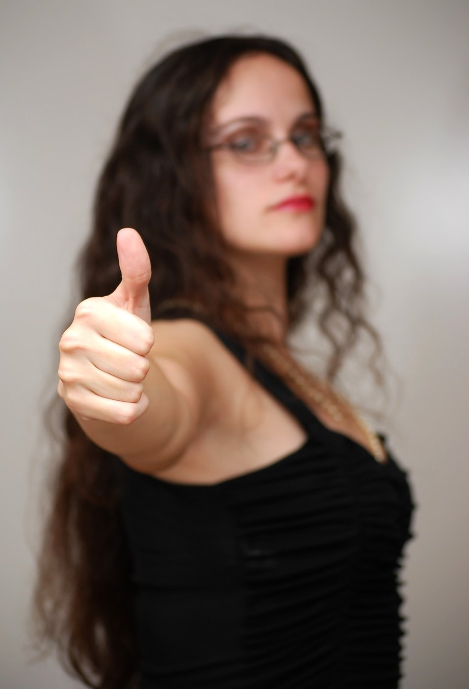 A beautiful business woman giving a thumbs up : Free Stock Photo