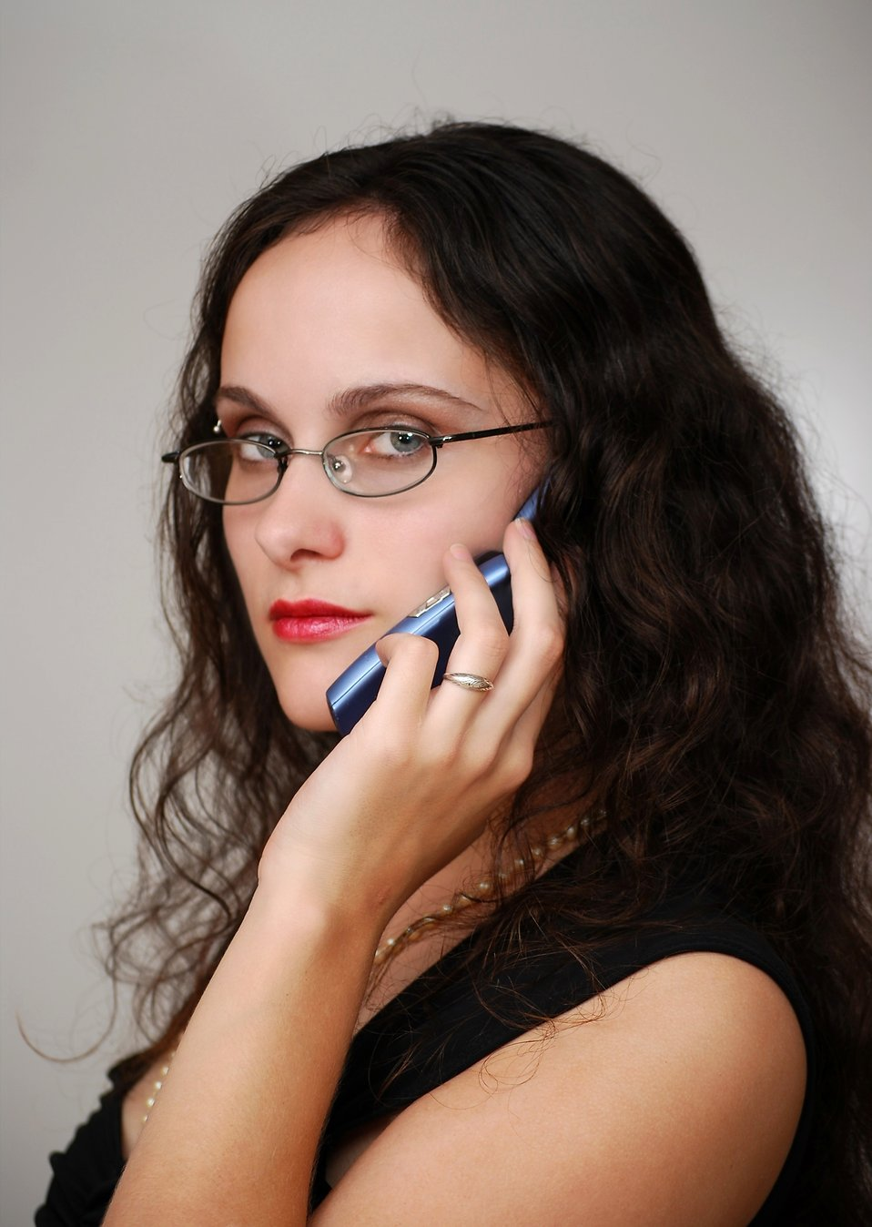 A beautiful business woman talking on a cell phone : Free Stock Photo