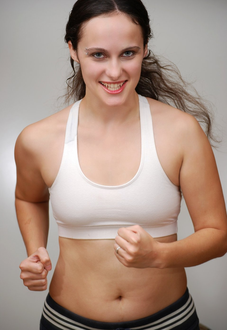 A beautiful young woman exercising : Free Stock Photo