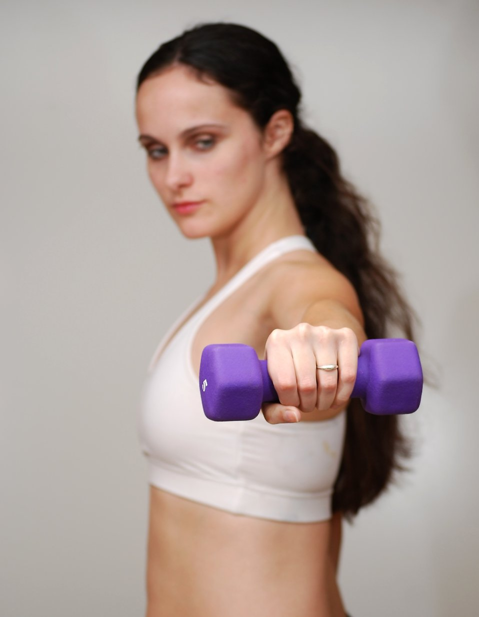A beautiful young woman exercising with weights : Free Stock Photo