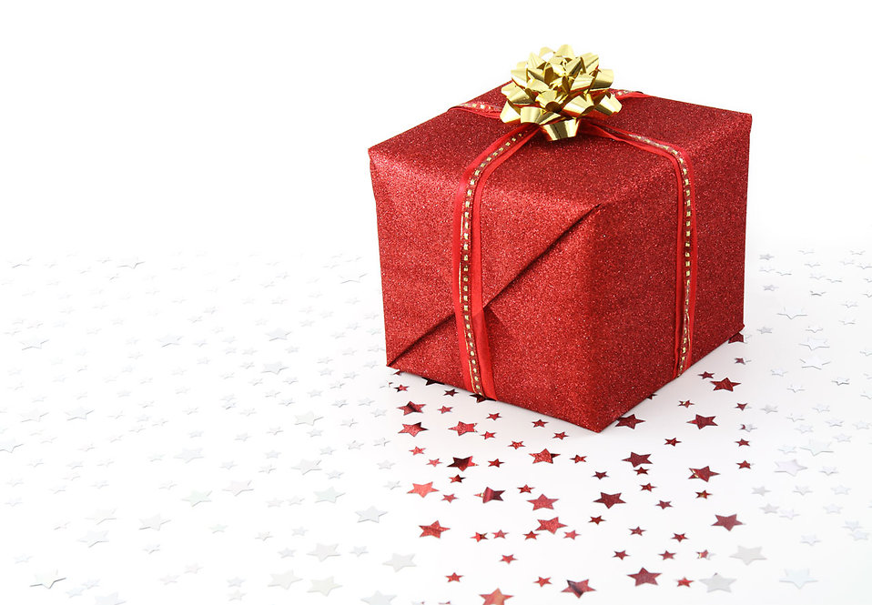 A red Christmas present isolated on a white background.