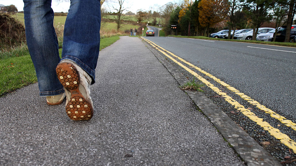 Close-up of feet walking on a road : Free Stock Photo