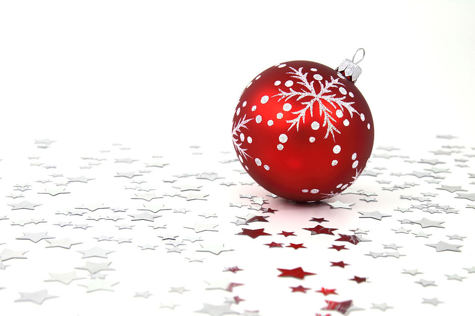 A red Christmas ornament with silver stars on the floor : Free Stock Photo