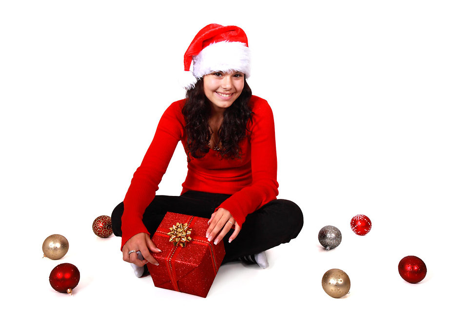 A beautiful young woman with a Christmas gift on a white background : Free Stock Photo