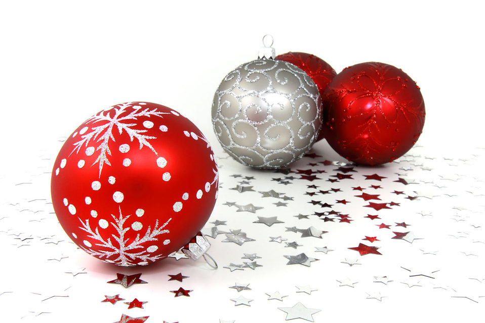 Red and silver Christmas ornaments with silver stars on a white floor : Free Stock Photo