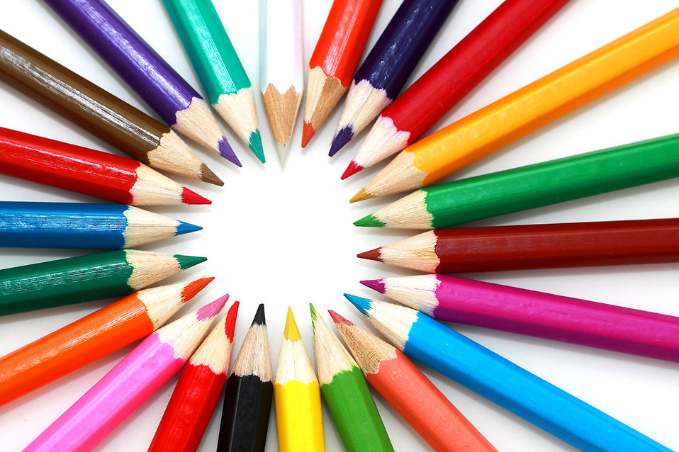 Colored pencils in a circle isolated on a white background.