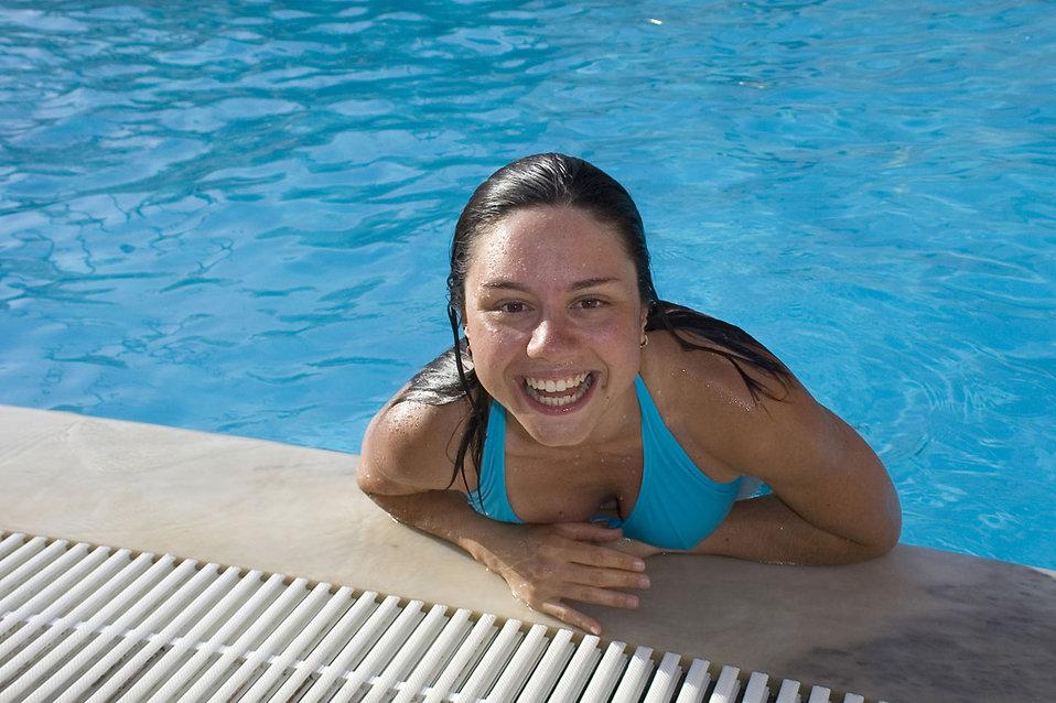 A beautiful young woman having fun in a pool : Free Stock Photo