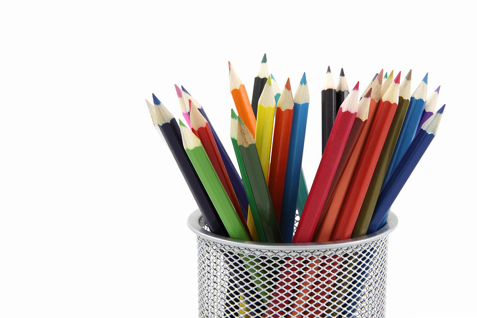 Colored pencils in a pencil holder isolated on a white background : Free Stock Photo