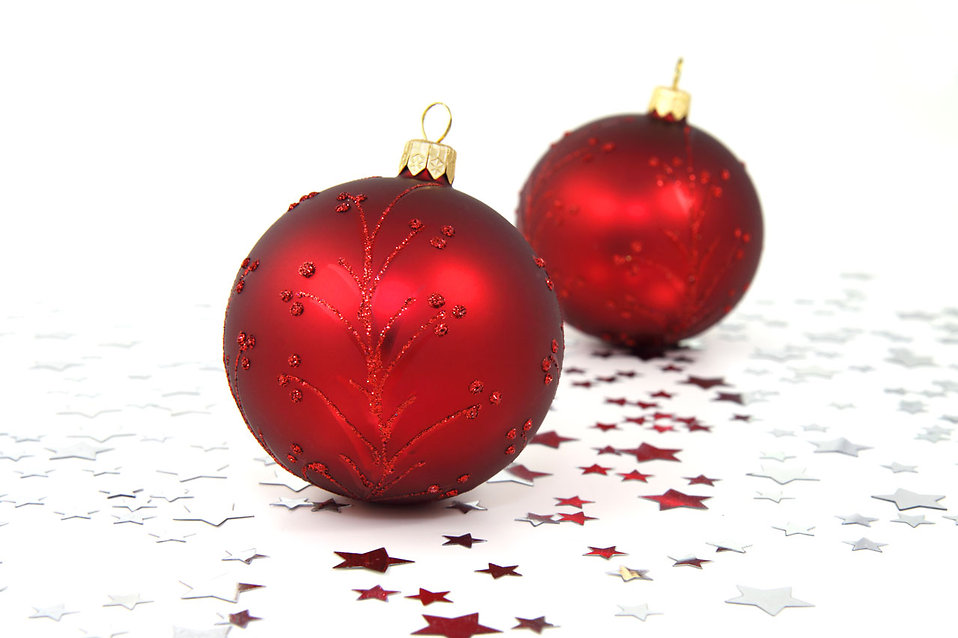 Two red Christmas ornaments with silver stars on the floor : Free Stock Photo