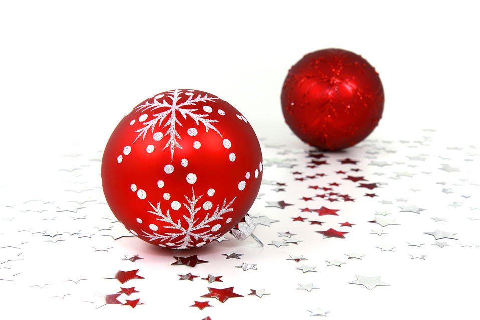 Red Christmas ornaments with silver stars on a white floor : Free Stock Photo