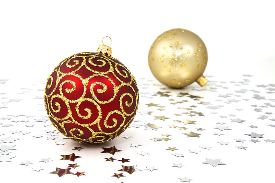 red and gold christmas ornaments on a white floor with silver stars free stock photo