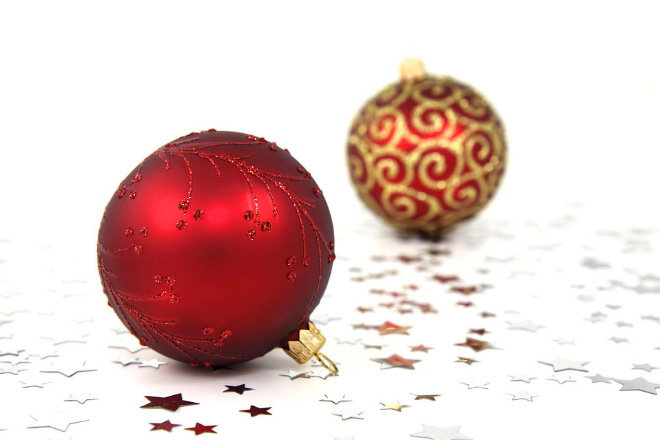 Two red Christmas ornaments on a white floor : Free Stock Photo