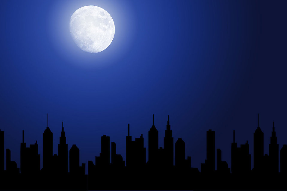 A night cityscape silhouette with the moon.