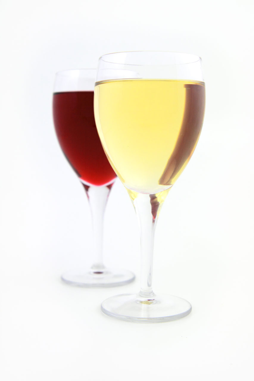 Glasses of red and white wine isolated on a white background.