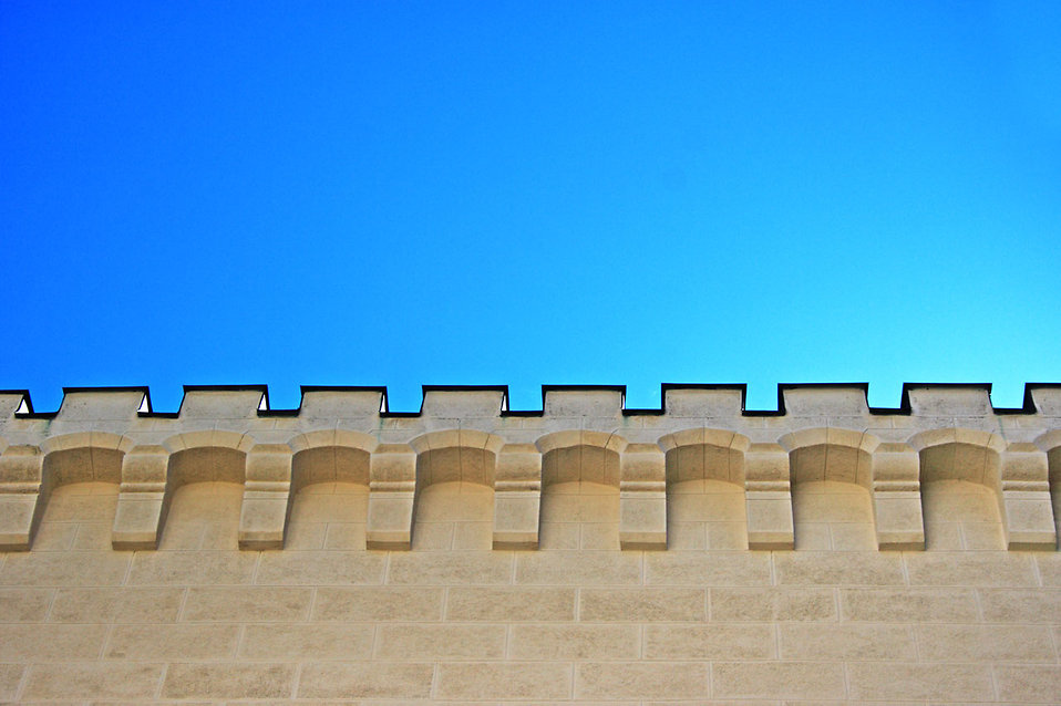 A castle wall against a blue sky : Free Stock Photo
