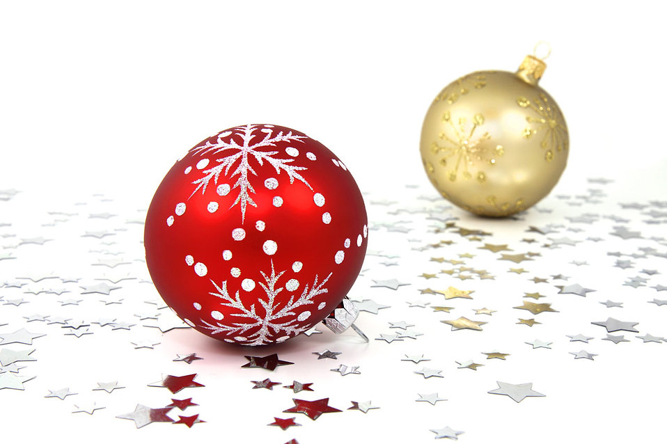 Red and gold Christmas ornaments on a white floor with silver stars : Free Stock Photo