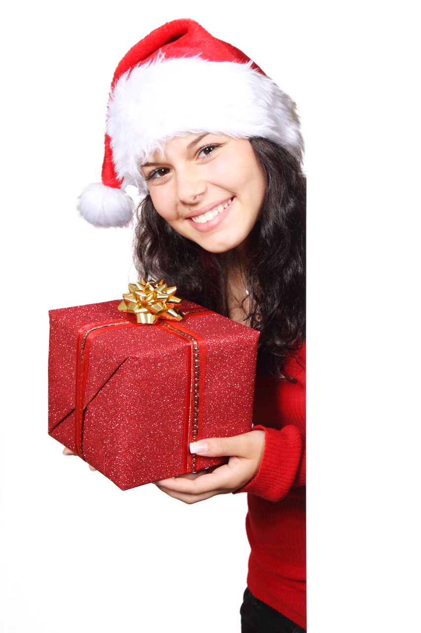 A beautiful young woman with a Christmas present.