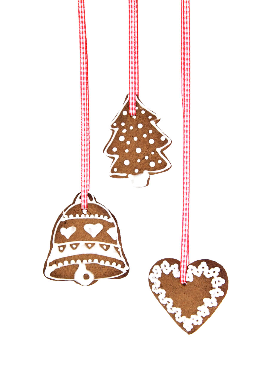 Christmas shaped gingerbread cookies hanging on a ribbon : Free Stock Photo