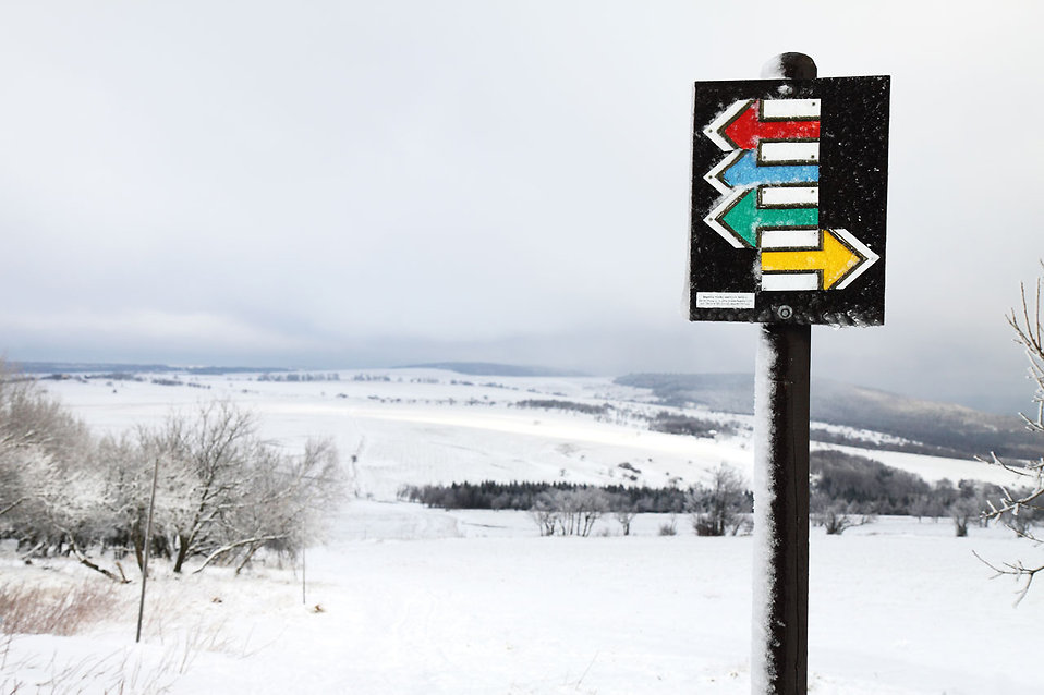 A tourist signpost in the snow : Free Stock Photo
