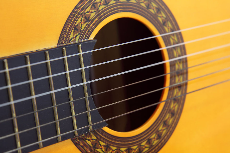 Close-up of an acoustic guitar : Free Stock Photo