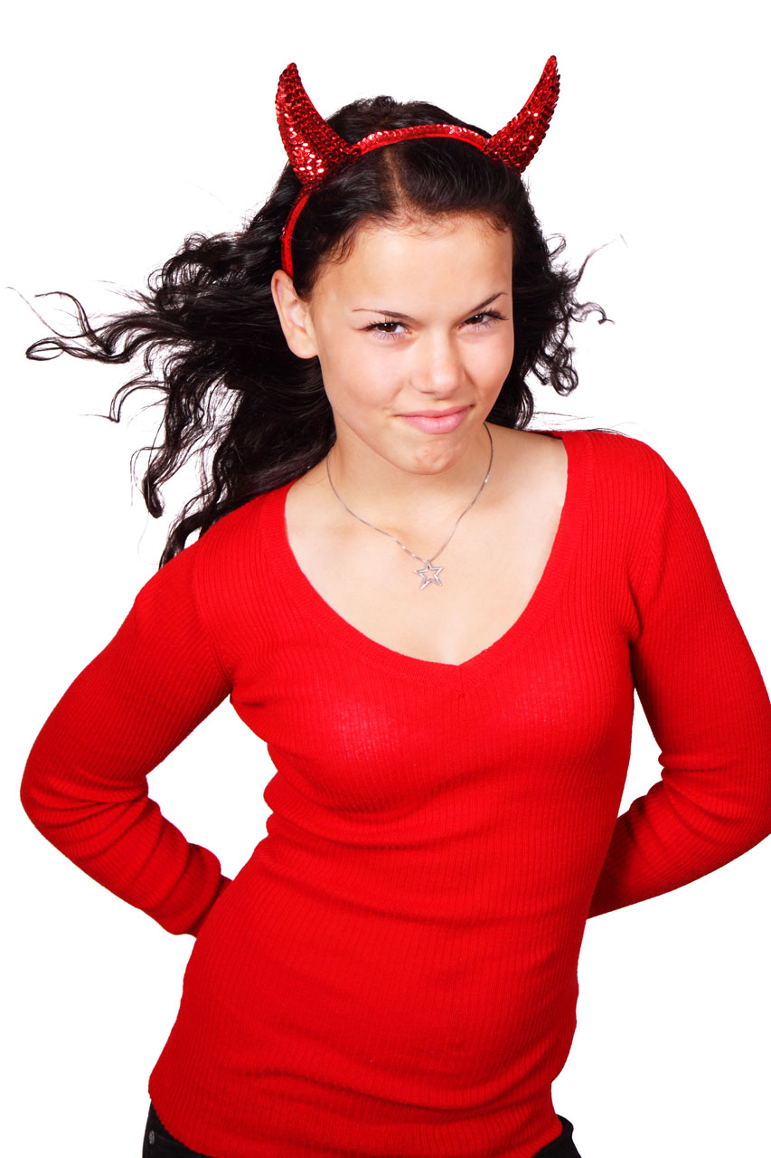 A beautiful girl in a red devil costume isolated on a white background : Free Stock Photo