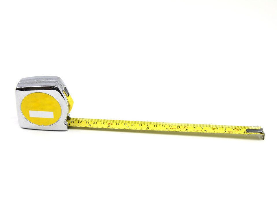 A measuring tape isolated on a white background : Free Stock Photo