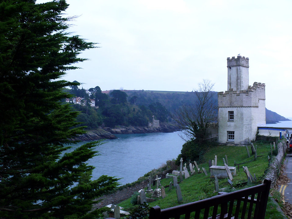 A graveyard in front of Dartmouth Castle : Free Stock Photo
