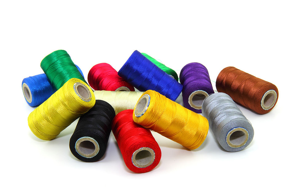 Spools of sewing thread isolated on a white background : Free Stock Photo