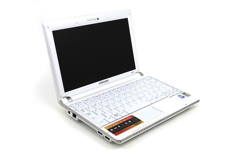 A white laptop isolated on a white background : Free Stock Photo