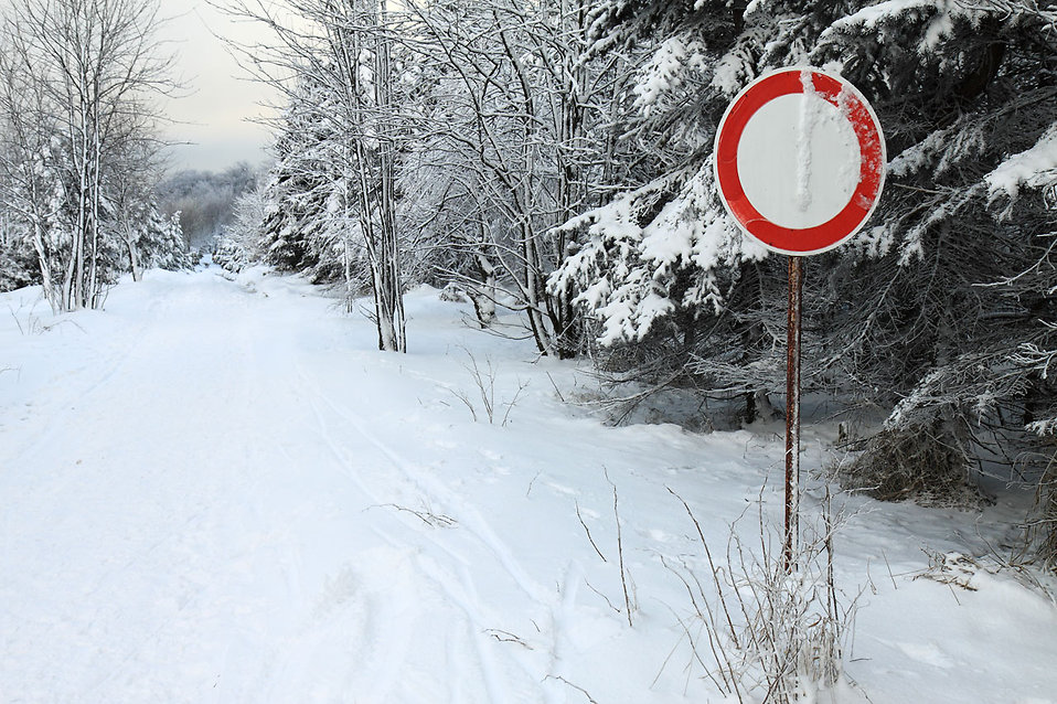 A snow covered path with a no vehicles sign : Free Stock Photo