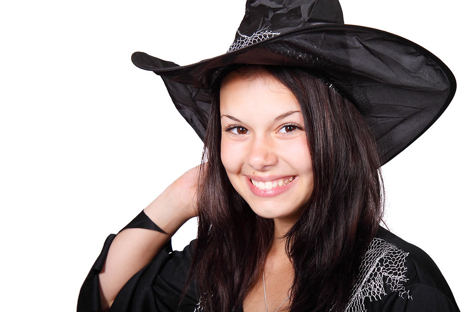 A beautiful girl in a Halloween witch costume : Free Stock Photo