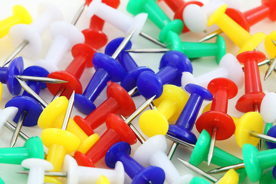 Colorful push pins isolated on a white background : Free Stock Photo
