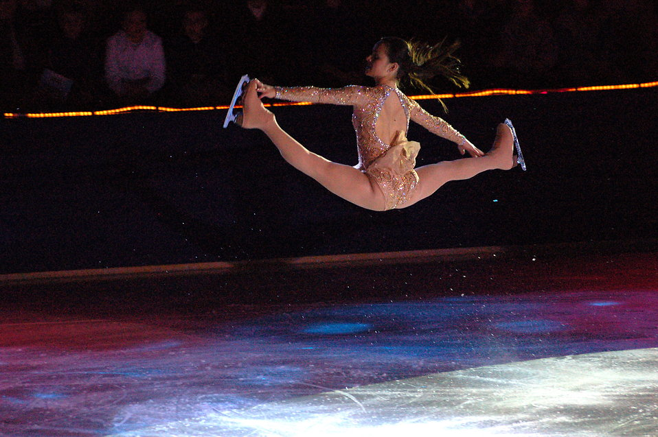 Figure skater Sasha Cohen in a very high jump : Free Stock Photo