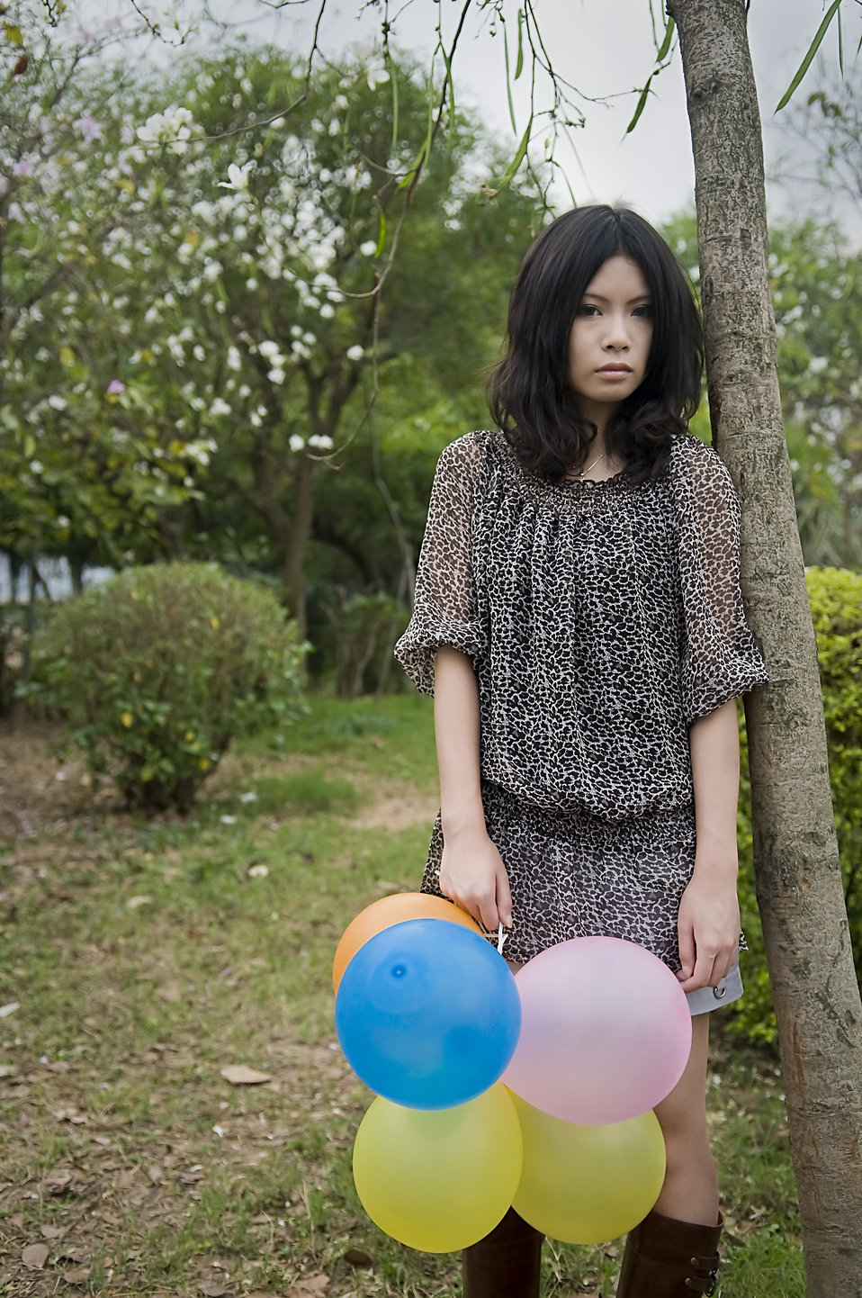 A beautiful Chinese girl posing outdoors with balloons : Free Stock Photo