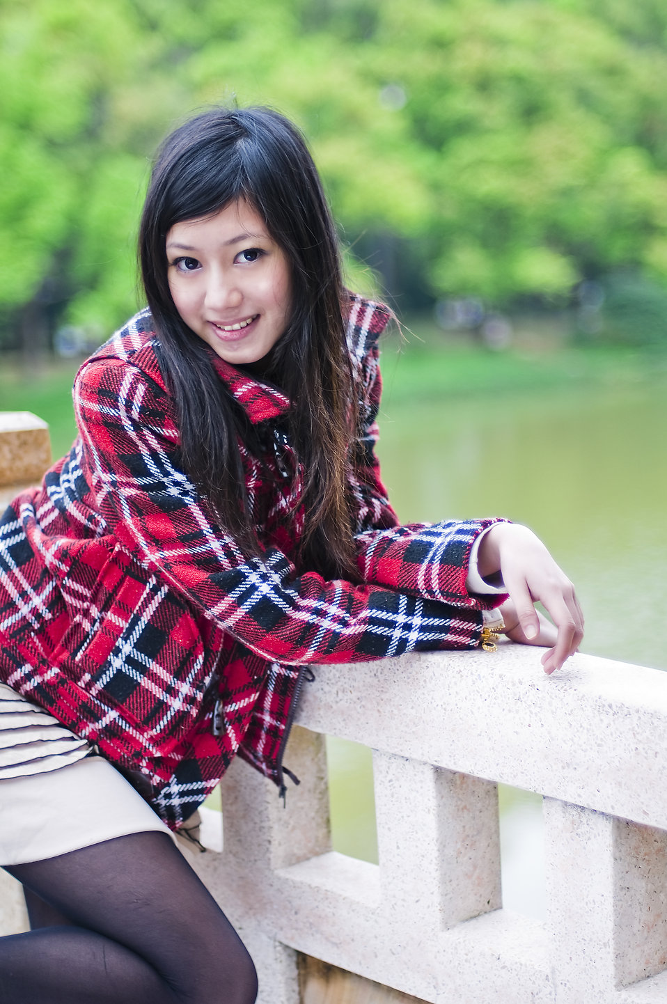 A beautiful Chinese girl posing outdoors : Free Stock Photo