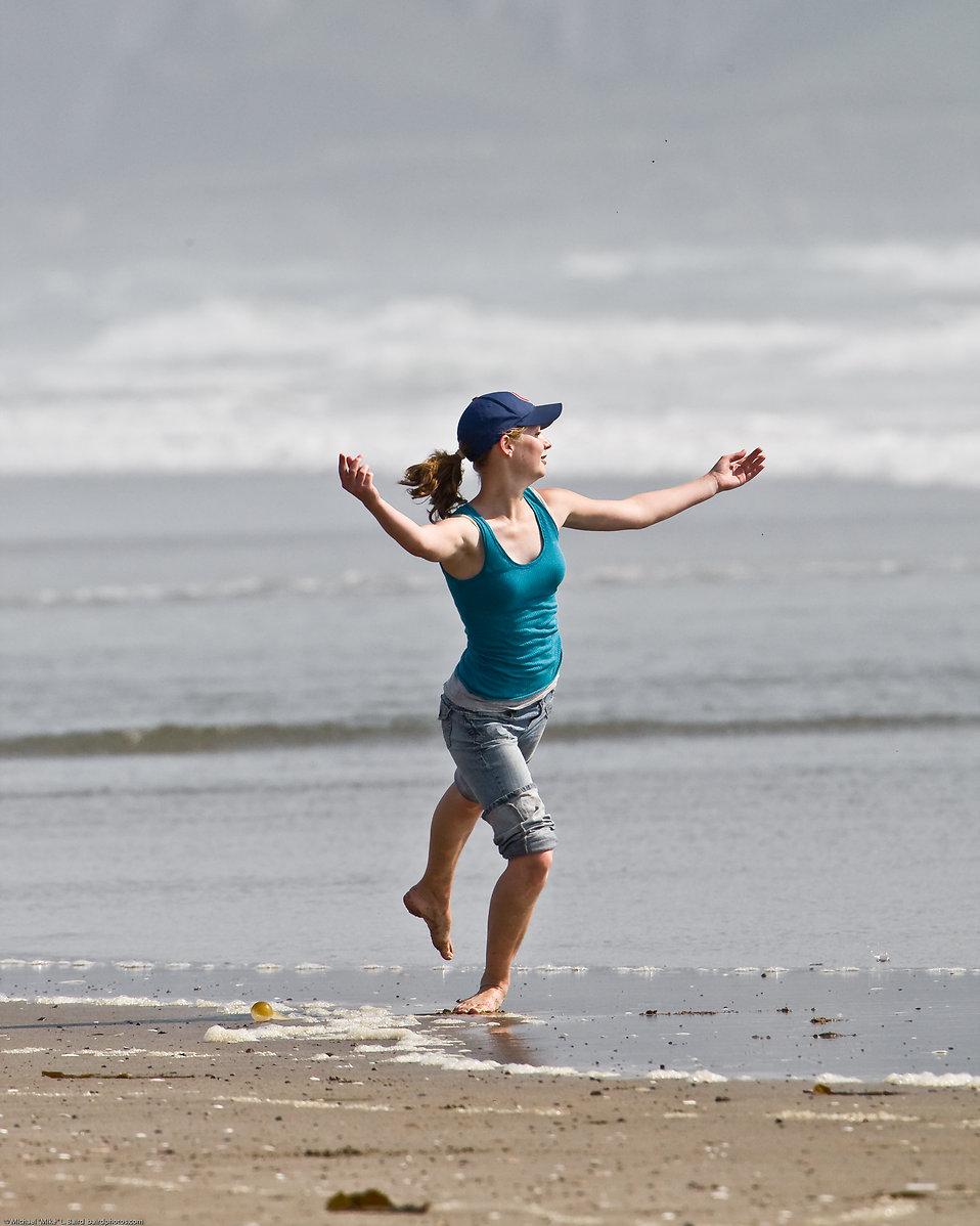 A beautiful girl jumping on a beach : Free Stock Photo