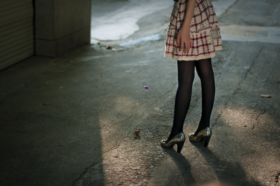 Female legs and a dress standing outside : Free Stock Photo