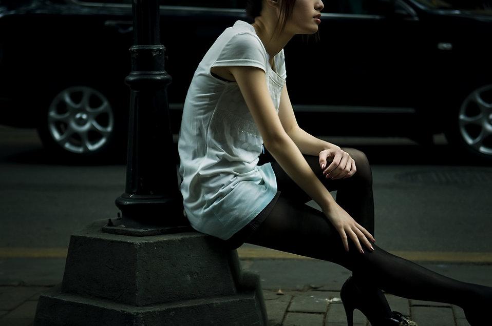 A beautiful Chinese girl posing outdoors : Free Stock Photo