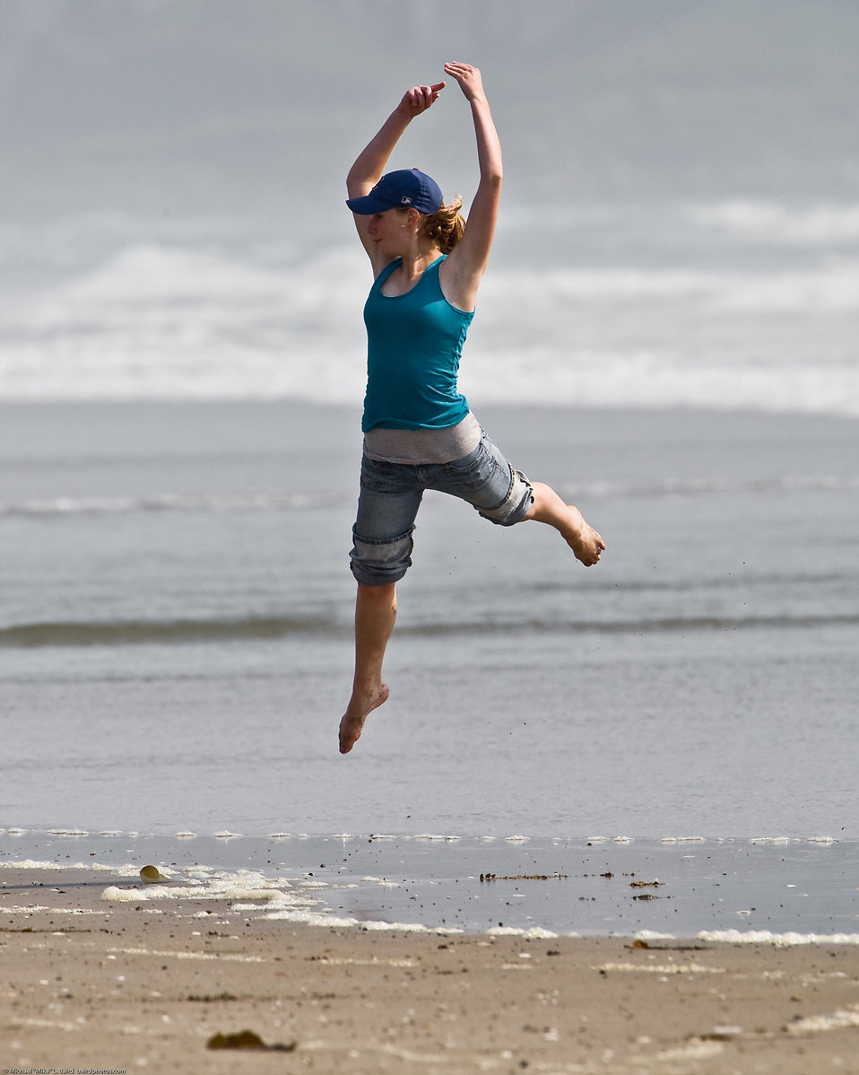 A girl jumping on the beach : Free Stock Photo