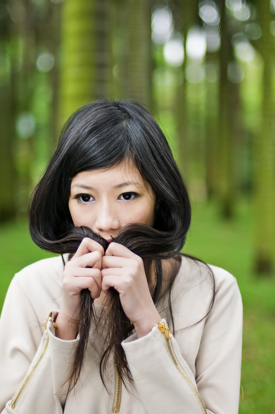 A beautiful Chinese girl posing in the woods : Free Stock Photo