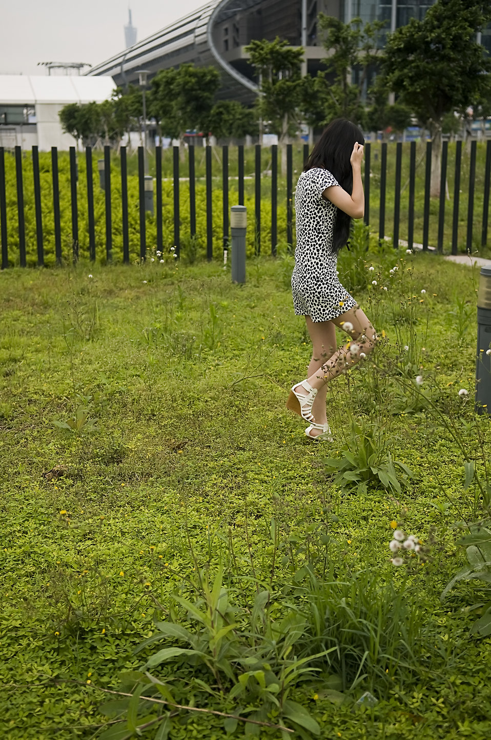 A beautiful Chinese girl walking in the grass : Free Stock Photo