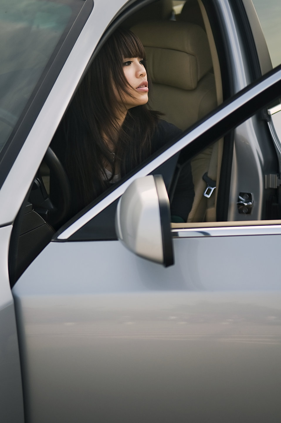 A beautiful Chinese girl getting out of a car : Free Stock Photo