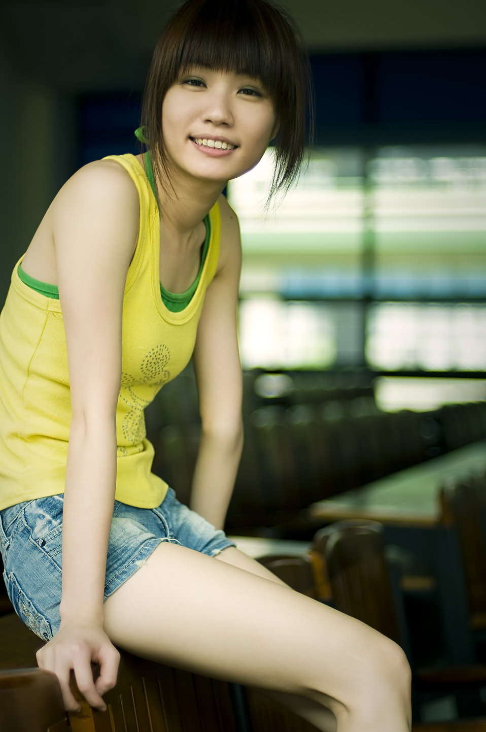 A beautiful Chinese girl posing indoors : Free Stock Photo