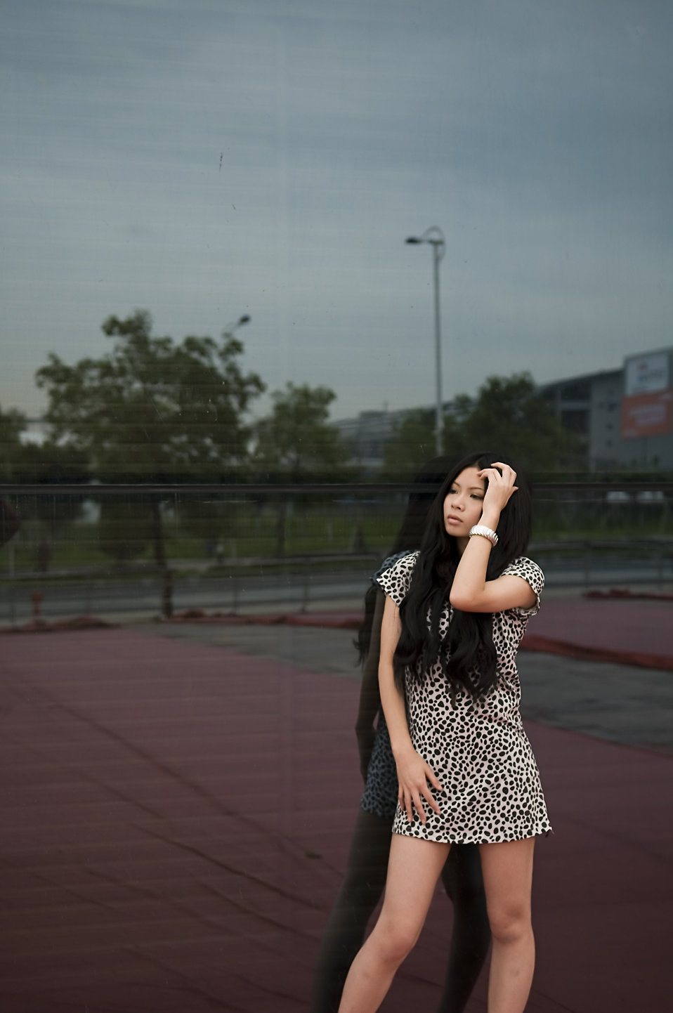 A beautiful Chinese girl posing against a wall : Free Stock Photo