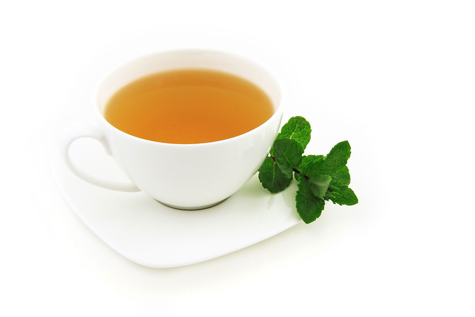 A cup of mint tea on a white background : Free Stock Photo