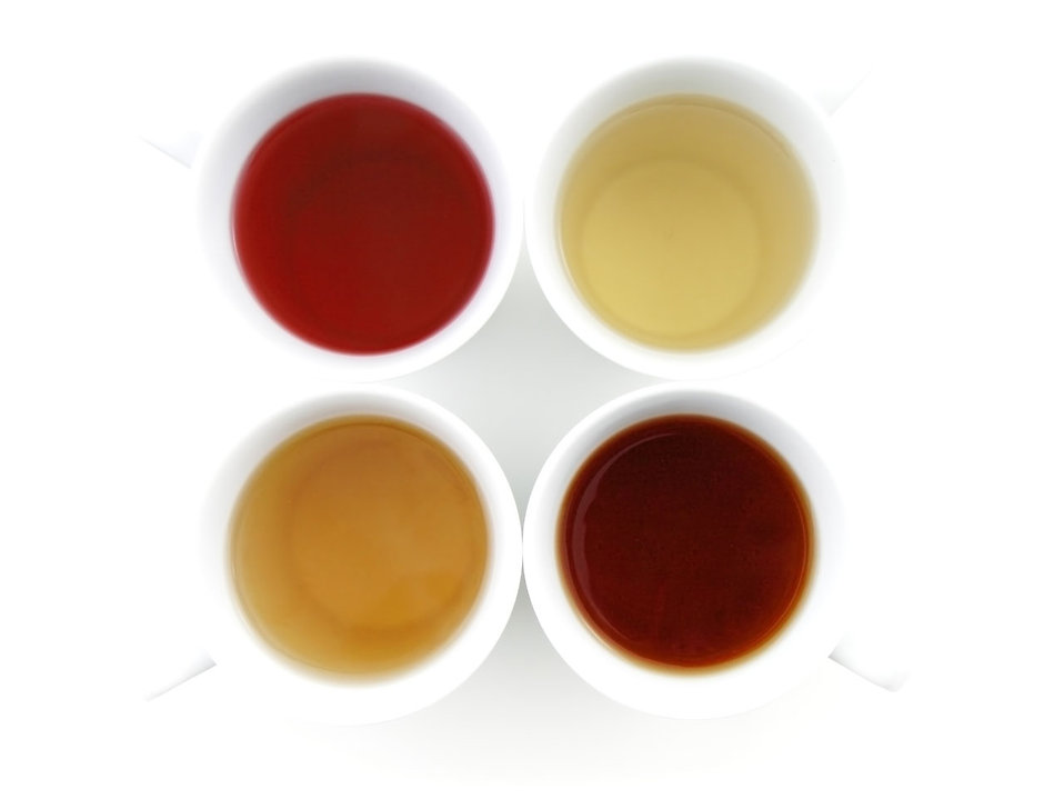 Four cups of tea - black, green, cherry and camomile : Free Stock Photo